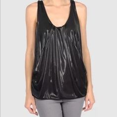 NWT Diane von Furstenburg 6 wet look liquid top This is a brand new with tags, sexy tunic tank from high-end designer Diane von Furstenburg. Size-6 US. Wet look metallic fabric descends from a pleated, draped neckline to a bubble style hemline. 2 pockets. Dress this up or down as it is great with jeans, a career suit, or perfect for a cocktail dinner! 100% poly. Shiny finish. Diane von Furstenberg Tops Tank Tops