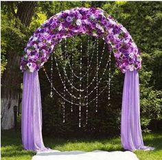 I love this look! The colors, the draping crystals, all the flowers. May be a bit expensive, even with fake flowres
