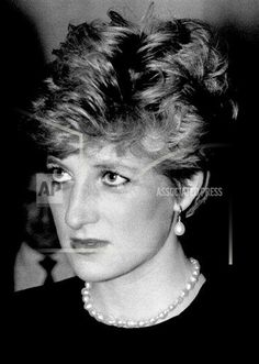 A British newspaper reported that Princess Diana, shown Feb. 6, 1992, in despair over her marriage and convinced that her two sons were happier with their nanny than her, took an overdose of pills six years ago. The Daily Mail claimed in its front page article that non-identified palace insiders said the aborted suicide was never intended to be more than a agonized cry for help. (AP Photo/Nigel Marple)