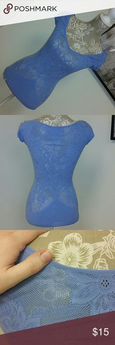 """Intimately Blue Top Free People NWOT never worn xs/s Intimately blue nylon spandex top. Laid flat, it's 23.5"""" from the shoulder to the hem, 22"""" across and very stretchy. Free People Tops Tees - Short Sleeve"""