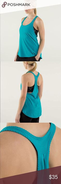 Lululemon 105 F Singlet *Silver in Surge Lululemon 105 F Singlet *Silver in Surge. Perfect lightweight loose fit tank. Teal with micro gray stripes. Seriously light luon material. Perfect condition. No rip tag. No size dot. Size 10. lululemon athletica Tops Tank Tops