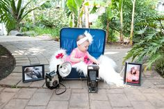 Cute idea to have the younger pictures. :) I had the parents bring pictures of the baby as a newborn and 3 months and then we put them in frames with her in the middle... for her 6 month pics