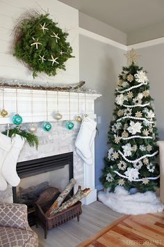 Christmas Mantel - A birch branch holds ornaments, snowy lights and stockings! Christmas House Tour at The Inspired Room