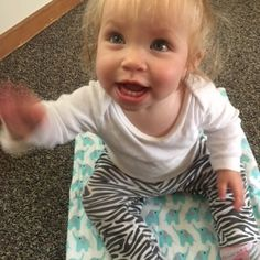 Madison enjoys a Piperoos Eco Friendly Baby Change Pad. Product Review by Brittany over at anchoredmommy.com