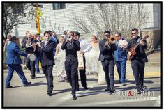 The Sugarbabies band marching with the Bride & Groom to the Essex Room from the local church!  Lots of fun!  #sugarbabiesband #sugarbabies #essexroom #northshoreweddingphotography #benoit&mccarthyphotography #marchingband