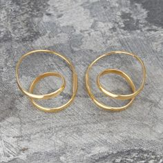 Double Loop Gold Hoop Earrings - Cool, contemporary and utterly unique, these Double Loop Gold Hoop Earrings feature a looped curl design for maximum impact and minimal fuss. #Otisjaxon #Jewellery