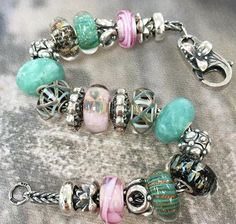 Pink, Black, and Turquoise Trollbeads combination. From top to bottom glass and stone beads are Rose Ribbon, Soulmates, Pure Heart, Amazonite, Chances, Wild Flowers, Chances, Amazonite, Pure Heart, Soulmates, and Pink Ribbon