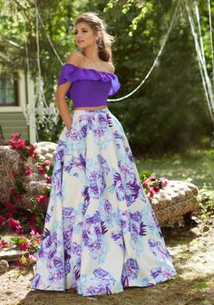 Prom Dresses by Morilee designed by Madeline Gardner. Fun and flirty Two-Piece Prom Dress with Off-the-Shoulder Ruffled Neckline and Floral Taffeta Skirt.