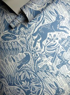 Mark Hearld's 'Harvest Hare' wallpaper for St Jude's, based on an original linocut print https://www.stjudesfabrics.co.uk/collections/mark-hearld/products/harvest-hare-wallpaper