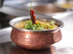 Diners Drive-Ins and Dives featured Gandhi Mahal Restaurant. Get their Dal Recipe from Food Network