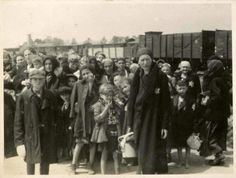 """Women and children on the Birkenau arrival platform known as the """"ramp"""". The Jews were removed from the deportation trains onto the ramp where they faced a selection process- some were sent immediately to their deaths, while others were sent to slave labor. Women and children - seen as less valuable to the Reich - were most likely to be sent to the left (lings), which led to the gas chambers, instead of to the right (rechts) which led to possible survival."""