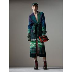 A longline cardigan coat that takes 20 hours to knit and assemble. Cashmere, wool and mohair is patchworked into traditional Fair Isle and cable-knit mouliné, with hand-embroidered detailing. Cinch the soft silhouette with the tartan belt.
