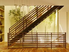 All-wood modern railing.  I'd like the horizontal members to be slimmer.  By Design Line Construction, Inc., Houzz.