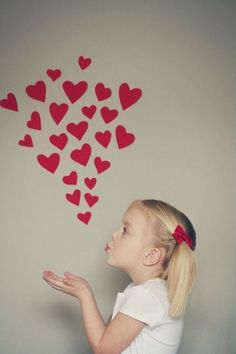 photo booth idea with hearts attached to the wall