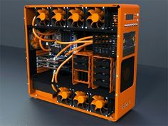 Orange and black computer PC tower setup liquid cooled