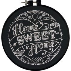 "Home Sweet Home Embroidery Kit This chalkboard style Home Sweet Home is the perfect introduction to embroidery. Stitch and finish in the included hoop. Kit includes: cotton thread, printed black fabric, 6"" plastic hoop, needle, easy instructions. Finished size: 15cm, 6"" diameter. Brand: Dimensions £9.99"