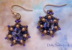 14mm amethyst rivoli earrings modified from Sabine Lippert Les Fleurs necklace.  3mm Swarovski xilion purple velvet bicones, 15/0 Miyuki Matte Metallic gold seeds.  No info on 11/0's or 3mm pearls. My sister loves purple and it's so difficult to make purple jewelry without having it look like college colors.