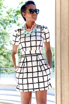 Awesome dress!  Almost perfect--needs to be knee length.  Like thebold print, the cap sleeves, the neckline, the tight waist.