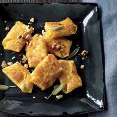 Butternut-Squash-and-Sage Wontons Recipe - Jill Donenfeld | Food & Wine. Wonton wrappers are terrific for making ravioli when you don't have time to make homemade pasta. The wontons here, filled with mashed butternut squash and roasted garlic, get nicely crispy when sautéed in a touch of oil, but they're also delicious simply steamed.
