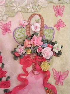 Crazy quilt with buttons,  beading, silk ribbon flowers, motifs and ornate embroidery  stitching.