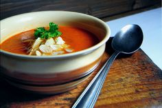 Warming paprika soup with almonds.