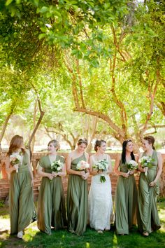Love the different dresses of same colour to suit each bridesmaid