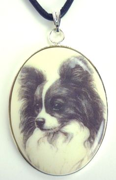 A Papillon Drawing on White Cabochon in Silver Tone by dogonitart, $8.99