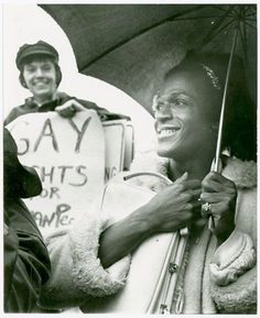 """Marsha P. Johnson (right) and Kady van Deurs, Gay Rights demonstration, City Hall, New York City, April 1973. Photo by Diana Davies, @nyplpicturecollection. """"I was no one, nobody, from Nowheresville, until I became a drag queen. That's what made me in New York, that's what made me in New Jersey, that's what made me in the world."""" – Marsha P. Johnson"""