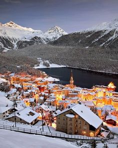 """St. Moritz Aglow Photograph by Susanne Kremer, SIME St. Moritz shines bright in wintertime. Read more about Switzerland in """"Swiss Tracks"""" in the April 2013 issue of National Geographic Traveler."""