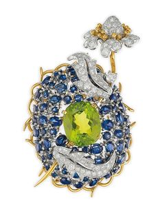 "A Peridot, Sapphire and Diamond ""Bleuet"" Brooch by Jean Schlumberger, Tiffany & Co. High Jewelry, Modern Jewelry, Tiffany & Co., Tiffany Jewelry, Tiffany Rings, Antique Jewelry, Vintage Jewellery, Antique Rings, Diamond Cuts"