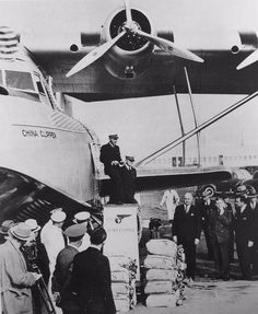 Edwin Musick and crew next to Pan Am's China Clipper flying boat before leaving San Francisco Bay with the first trans-Pacific airmail service, Nov. Airline Travel, Air Travel, Amphibious Aircraft, Pan Am, Flying Boat, Vintage Airplanes, San Francisco Bay, Aircraft Design, Boat Building
