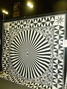This is great ~ an optical illusion in a quilt! ~ 2013 Paducah Quilt Show. I will add that the quilt was made by Brian Dykhulzen, a member of our Flathead Quilters Guild, Montana. Dresden Plate Quilts, 3d Quilts, Star Quilts, Tie Quilt, Patch Quilt, Optical Illusion Quilts, Optical Illusions, Monochromatic Quilt, Two Color Quilts