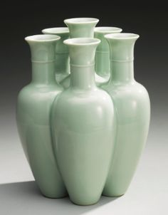 A RARE CELADON-GLAZED SIX-NECKED VASE (LIULIANPING) QIANLONG SEAL MARK AND PERIOD - Sotheby's