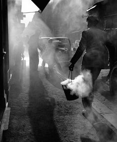 By Edouard Boubat - Through the smoke in the early morning foggy light. Magic light, shadows, and mist.
