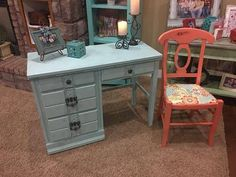 Darling desk painted in Annie Sloan Provence mixed with Bright White= light turquoise chalk paint, antiqued with dark wax with undertones of dark walnut.  It is also triple sealed with a polycrylic protective sealant   All the drawers slide and out with ease. Original hardware.  Chair is painted in Coral, antiqued and sealed also. New fabric added.   $165 Desk & Chair set  *decorations not included.  Measurement of desk: 41 long, 30.5 tall , 19 wide