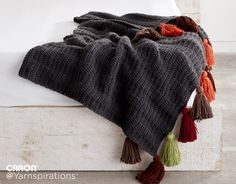 (Love the color of the tassels on this, although I'd probably choose a different color for the blanket, maybe dark brown or off white) Caron Color: Crochet Tasseled Throw - Yarnspirations Blog