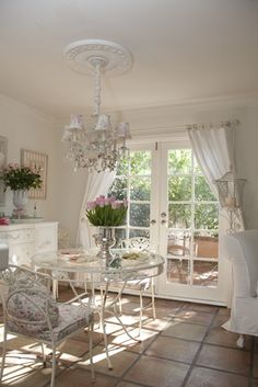 shabby chic in white--i love the vintage hats on the stands, the