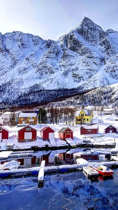 Download Wallpaper 720x1280 norway, mountains, buildings, bay, winter, snow Samsung Galaxy S3 HD Background