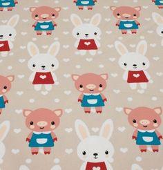 sandfarvet jersey med kaniner og grise