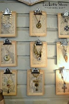 Necklace Display - clipboards hung on a wall show of each individual piece. Could work in a booth at a craft fair