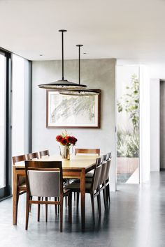Minimalistic dining room design | Catherine Kwong Design Open Floor House Plans, Outdoor Living Rooms, Dining Rooms, Living Spaces, Dining Room Lighting, Dining Room Design, Design Kitchen, Concrete Floors, Dining Table