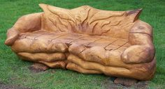 Chainsaw carved bench. Woodworking. Carving. Rustic.