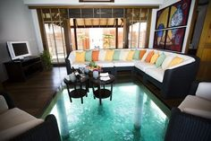 Another example of a transparent floor but applied in a more successful way (in my opinion). The potential in this image is the possibility of using transparency to highlight and frame a view of nature and subsequently connect a room, in this case to a turquoise pool.