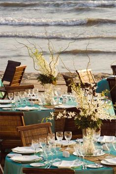 centerpieces all white with colored linens? #beach #wedding reception Puerto Vallarta