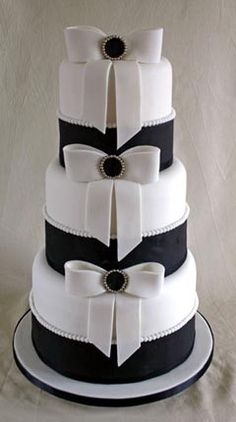 Black & white wedding cake with bows www.tablescapesbydesign.com https://www.facebook.com/pages/Tablescapes-By-Design/129811416695