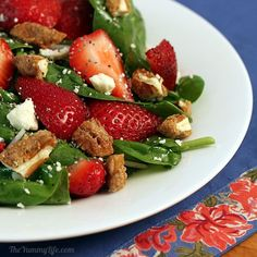spinach strawberry salad with Raspberry Poppy Seed Salad Dressing and Sugar & Spice Candied Pecans.