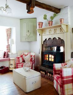 English country house .... I love the fireplace surround.