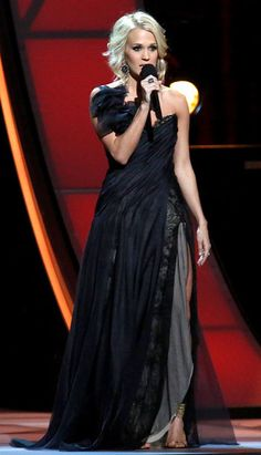 That's better! Carrie brought it back and had an Angelina Jolie moment in a black Ines DeSanto one-shoulder gown with a sexy thigh-high split. B