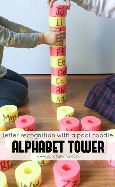 Alphabet Tower - Working on Letter Recognition, Hand Eye Coordination & Team Work! www.acraftyliving.com