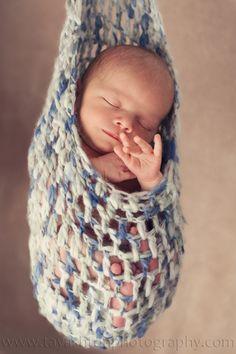 Xander 002 Newborn baby boy in stork sac. Photography by Tay Ashton